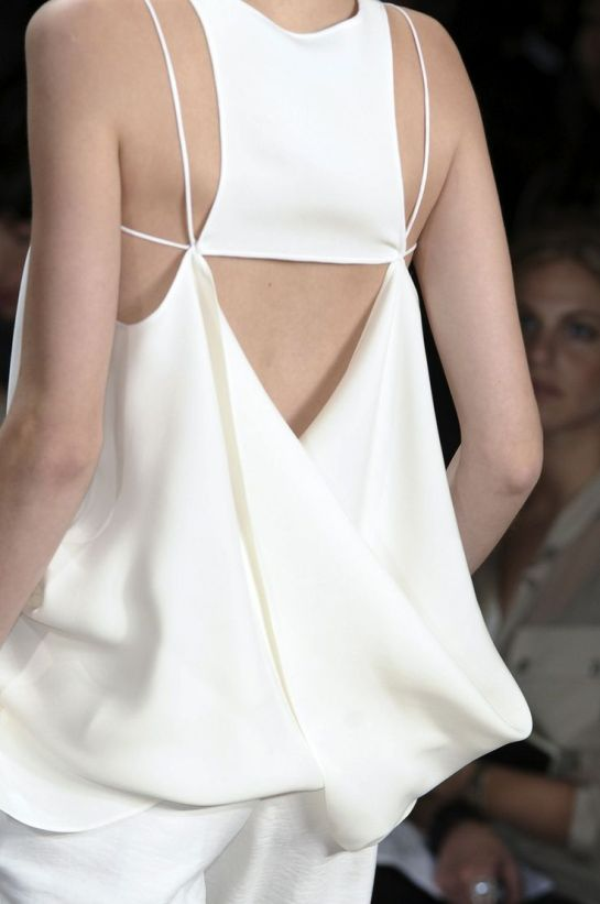 Line, drape & movement - all white, elegant simplicity; closeup fashion details